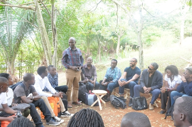 Participants and facilitators listens to Dr George   Kyeyune. Simon Njami is fourth seated from left to right.