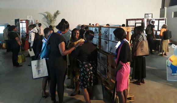 Visitors at the exhibition opening night at Design Hub Kampala